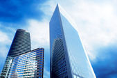 Modern office Skyscrapers on the sunny beautiful sky — Stock Photo