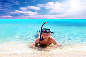Happy young man with snorkelling on a sea beach — Stock Photo