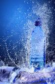 Buttle van water op het ijs. splash van water — Stockfoto
