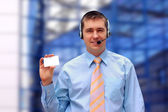 Businessman with card — Stock Photo