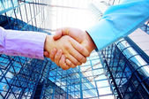 Shaking hands of two business — 图库照片