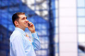 Businessman talking by phone — Stock Photo