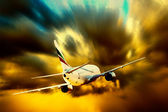 Silhouette of airplane on sunset sky — Stock Photo