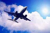 Airplane on blue sky — Stock Photo