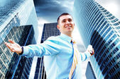 Hapiness Businessman standing on the business background — Zdjęcie stockowe