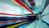 Train on speed in railway station — Stock Photo