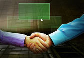 Handshake of two businessmans and text on the light button — Stok fotoğraf