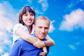 Happy couple on sky background — Stock Photo