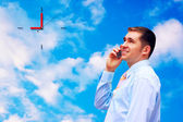 Happy businessmen on sky with clouds background — Стоковое фото