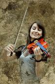 Hermosa mujer violinista tocando el violín en el grunge backgrou — Foto de Stock
