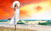 Young beautiful women in the white with pareo on the sunny tropi — Stock Photo