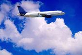 Airplane on blue sky — Stock Photo
