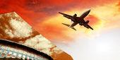 Airplane on the sunrise sky — 图库照片