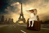 Little girl waiting on the road with her vintage baggage — Stock Photo