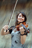 Playing violinist on the grunge background — Stock Photo