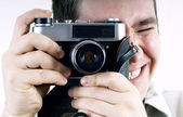 Happiness man with vintage photo camera. — Stock Photo