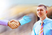 Man on background of Shaking hands of two business — Stock Photo