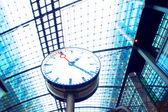 Clock in railway station — Stock Photo
