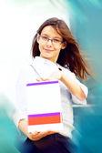 Gelukkig zakenvrouw op blured achtergrond — Stockfoto