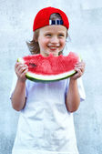 Child with part of watermelon, isolated on the white background — Stock Photo