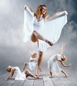 Woman dancer seating posing on background — Stock Photo