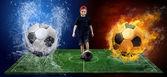 Niño y la bola en la cancha de fútbol con las bolas de fuego y aguas — Foto de Stock