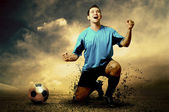 Shoot of football player on the outdoor field — Stock Photo