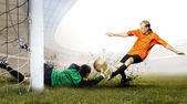 Shoot of football player and jump of goalkeeper on the field of — Stok fotoğraf