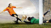 Shoot of football player and jump of goalkeeper on the field of — Stock Photo