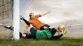 Shoot of football player and jump of goalkeeper on the field of — Zdjęcie stockowe