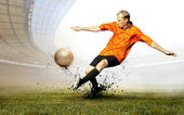 Shoot of football player on the field of olimpic stadium — Stock Photo