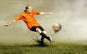 Shoot of football player on the outdoors field — Stock Photo