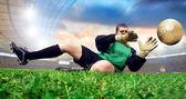 Jump of football goalman on the olimpic stadium — Stock Photo