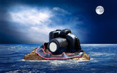 Cake from chocolate photocamera on the island in sea. — Stock Photo