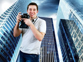 Happiness man with vintage photo camera — Stock Photo