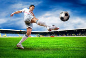 Happiness football player after goal on the field of stadium wit — Стоковое фото