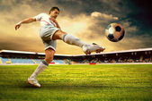 Happiness football player after goal on the field of stadium wit — Foto de Stock