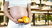 Happiness pregnant women in the white with orange — Stock Photo