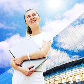 Young happy women or student with laptop on the business backgro — Stock Photo