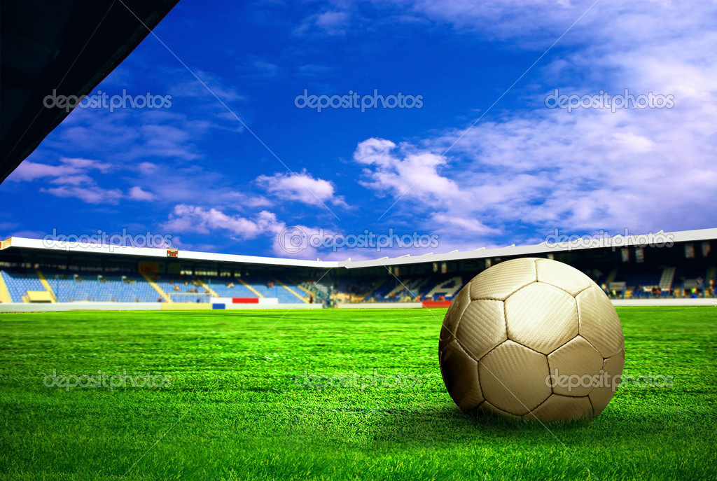 Happiness football player after goal on the field of stadium with blue sky — Stock Photo #6352741