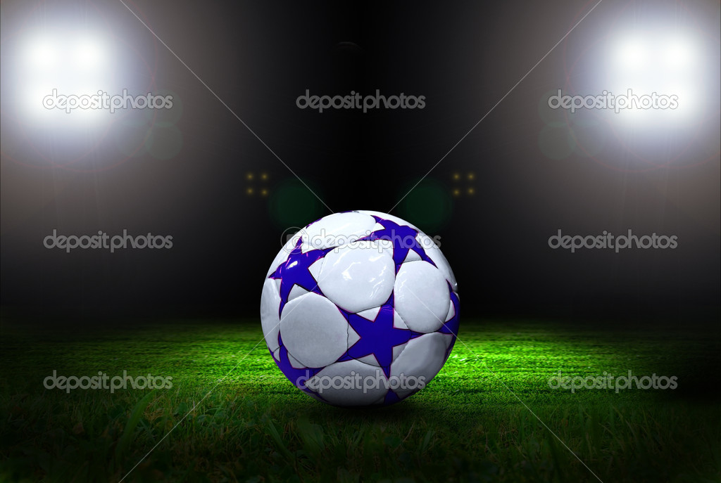 Soccer ball on the field of stadium with light — Stock Photo #6353678