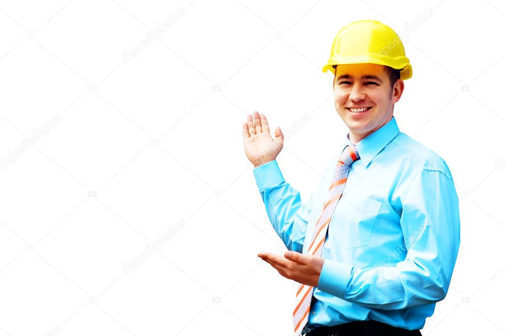 Young architect wearing a protective helmet standing on the building background — Stock Photo #6354450