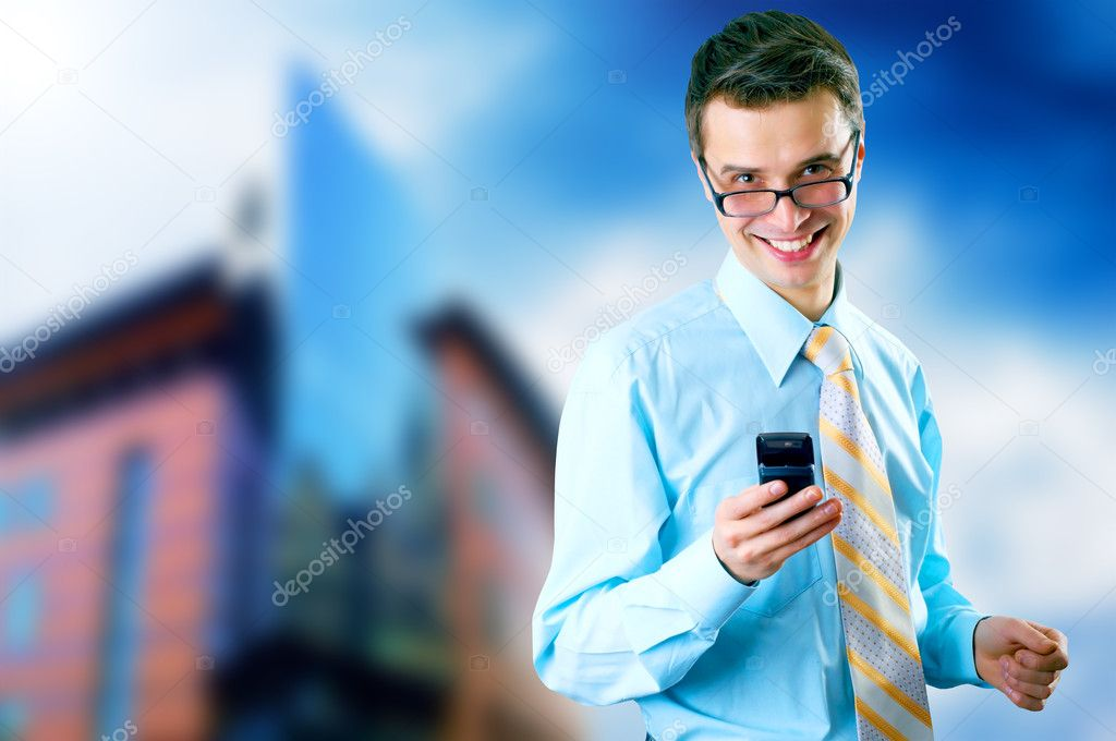 Hapiness Businessman standing on the business background — Stock Photo #6354519
