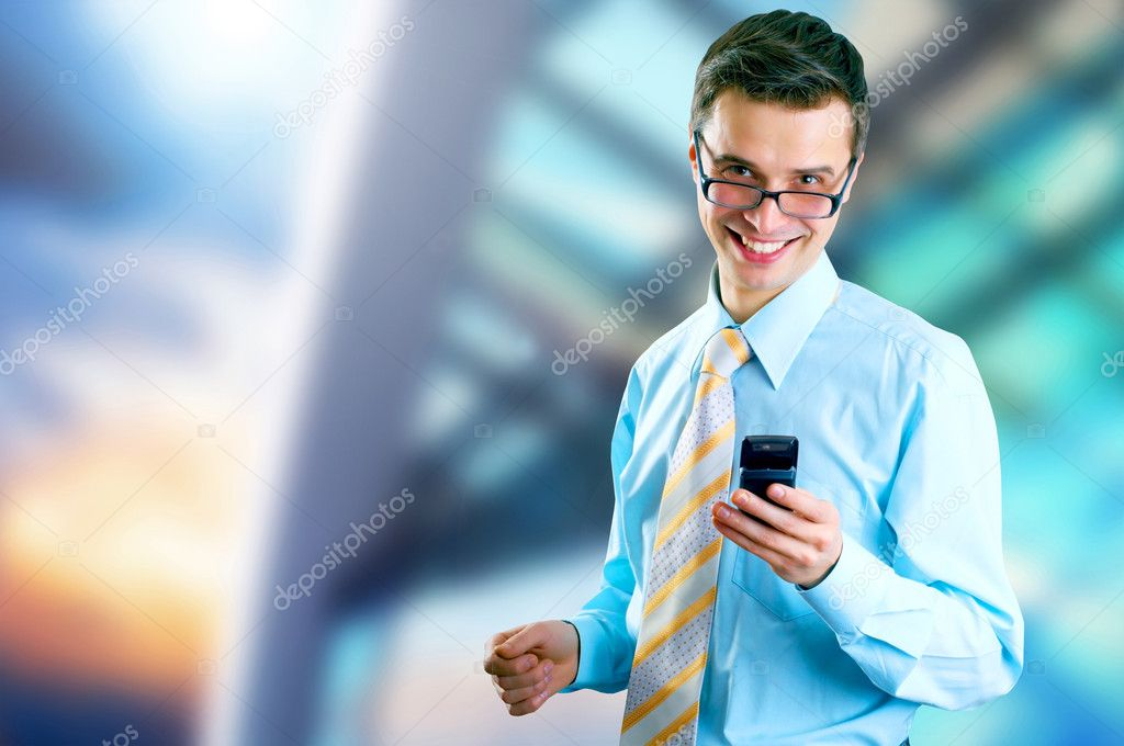 Hapiness Businessman standing on the business background — Stock Photo #6354521