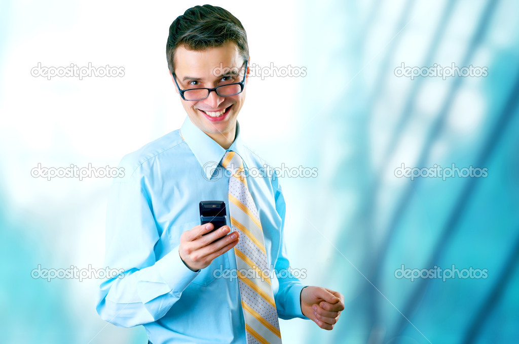 Hapiness Businessman standing on the business background — Stock Photo #6354522