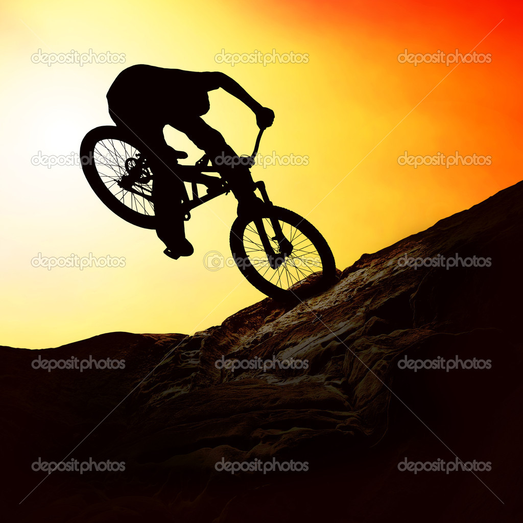 Silhouette of a man on muontain-bike, sunset — Stock Photo #6355606