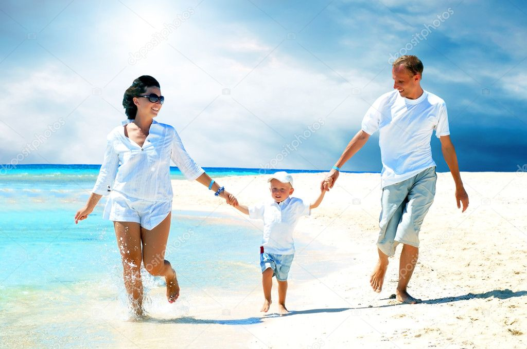 View of happy young family having fun on the beach — Stock Photo #6356373