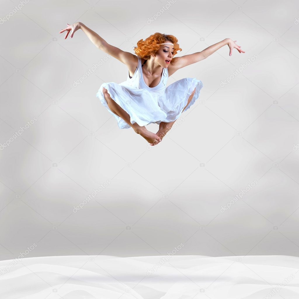 Jump of ballerina with dress of milk — Stock Photo #6356463