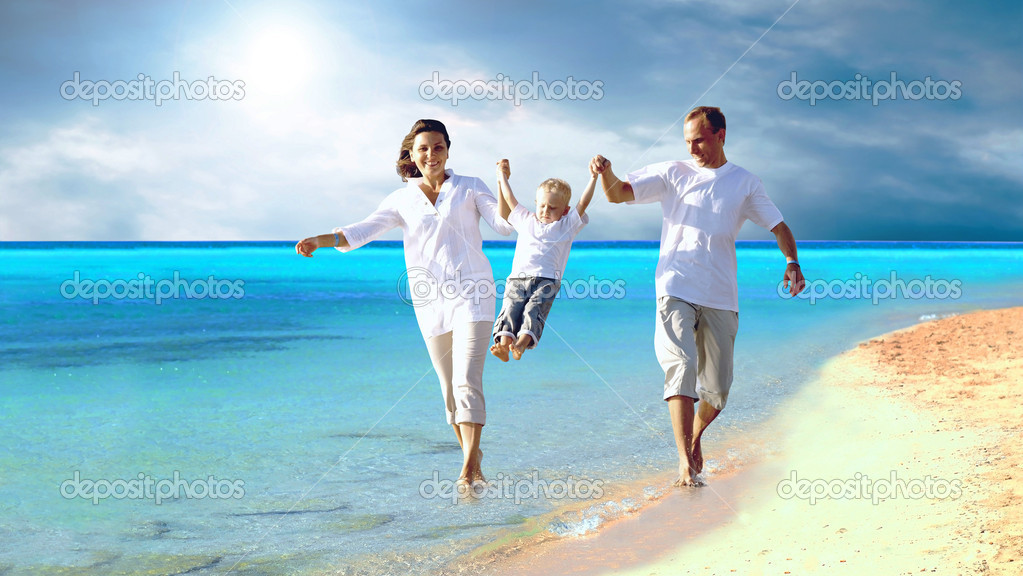 View of happy young family having fun on the beach — Stock Photo #6357126