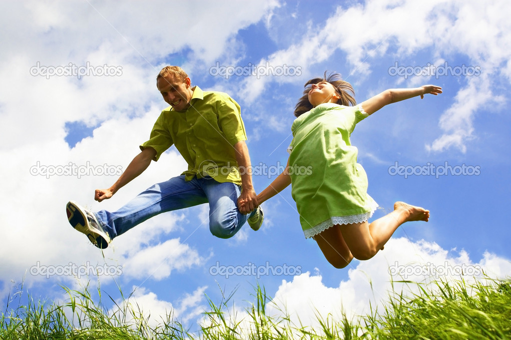 Fun couple in jump on the outdoor background — Stock Photo #6358414